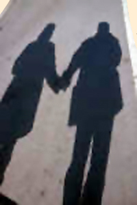 An image of couple and their shadows.