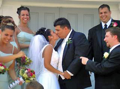 An image of a wedding kiss.