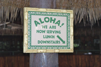 A photo of a sign seen in a Hawaiian restaurant.