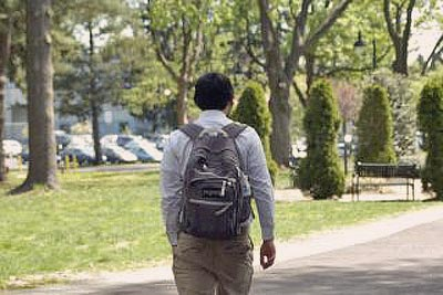 A photo of a student heading towards his class.