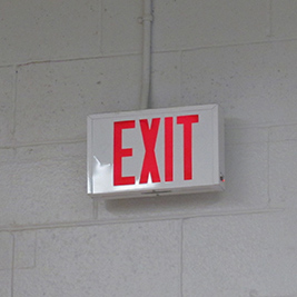 A photographic image of an exit sign.