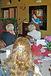 A photographic image of Mary Hunt 						Webb speaking to a group in Arizona.
