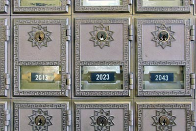 A photographic image of post office mailboxes.