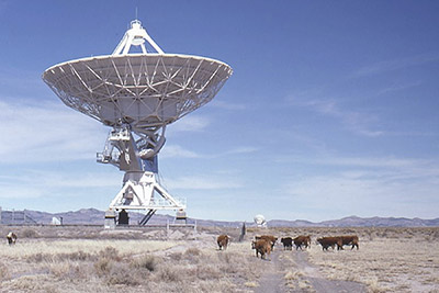 A photographic image of a radio telescope at the Very Large Array between Datil and Magdalena, New Mexico.