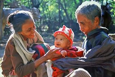 A photographic image of a mature couple with their grandchild.