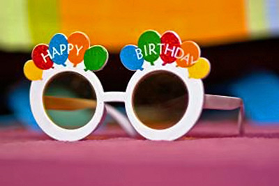 A photographic image of birthday glasses.