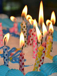 A photographic image of lit birthday candles.