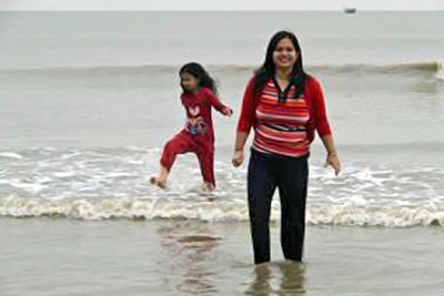 A photographic image of a mother and her daughter on a beach.